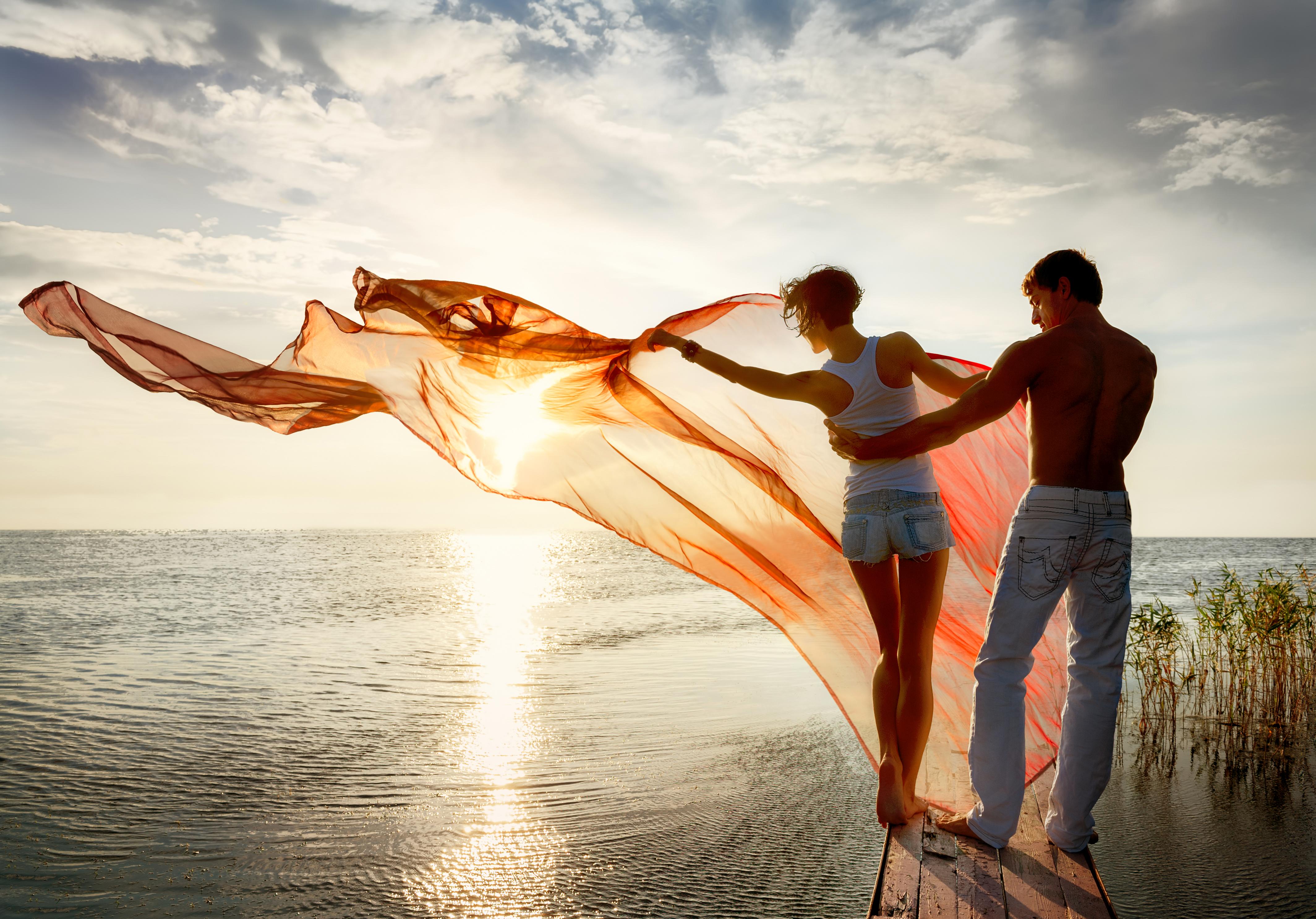 Couple on sunset background